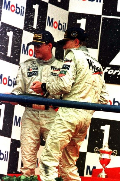 1997 European Grand Prix.Jerez, Spain.24-26 October 1997.Mika Hakkinen and David Coulthard celebrate finishing in 1st and 2nd positions for McLaren Mercedes-Benz.World Copyright - LAT Photographic