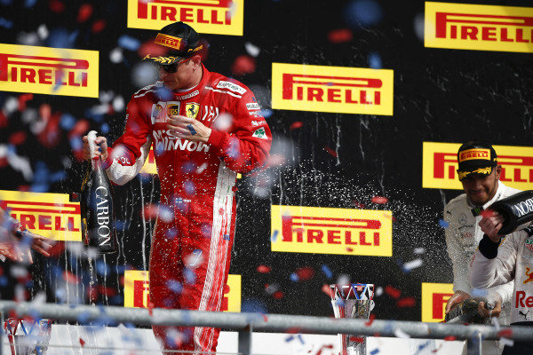 Kimi Raikkonen, Ferrari, 1st position, celebrates with Champagne on the podium