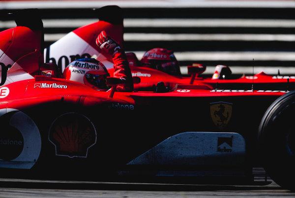 2002 Italian Grand PrixMonza, Italy. 14th - 16th September 2002Michael Schumacher, Ferrari F2002 and Rubens Barrichello, Ferrari F2002.World Copyright - LAT Photographicref: 35mm Transparency 02_ITA_29