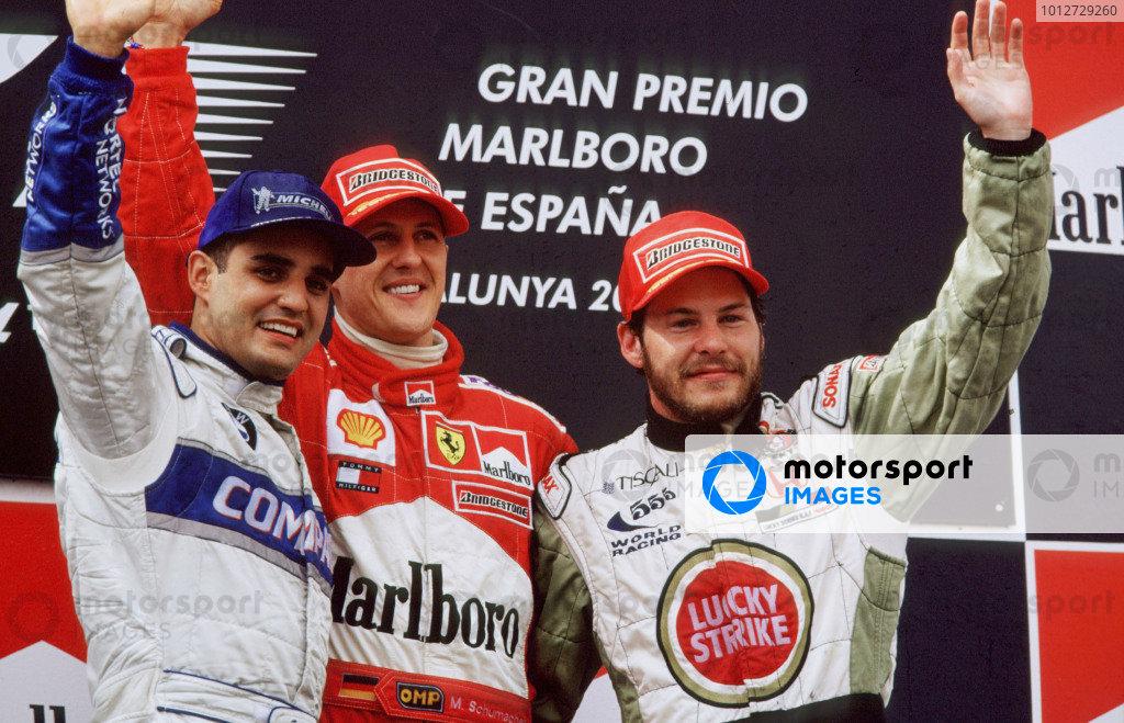 2001 Spanish Grand Prix Catalunya, Barcelona, Spain.  27-29 April 2001. Juan-Pablo Montoya (Williams BMW) 2nd position, Michael Schumacher (Ferrari) 1st position and Jacques Villeneuve (B.A.R. Honda) 3rd position, celebrate on the podium. World Copyright - LAT Photographic ref: 35mm Image