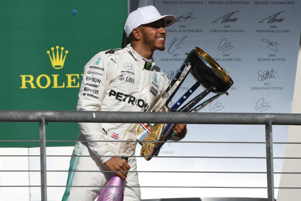 Race winner Lewis Hamilton (GBR) Mercedes AMG F1 celebrates on the podium with the champagne and the trophy at Formula One World Championship, Rd17, United States Grand Prix, Race, Circuit of the Americas, Austin, Texas, USA, Sunday 22 October 2017.