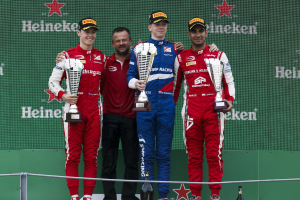 AUTODROMO NAZIONALE MONZA, ITALY - SEPTEMBER 07: Marcus Armstrong (NZL) PREMA Racing, Race winner Robert Shwartzman (RUS) PREMA Racing and Jehan Daruvala (IND) PREMA Racing on the podium during the Monza at Autodromo Nazionale Monza on September 07, 2019 in Autodromo Nazionale Monza, Italy. (Photo by Joe Portlock / LAT Images / FIA F3 Championship)