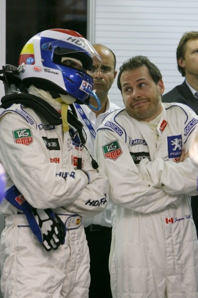 L-R: Marc Gene (ESP) Team Total Peugeot chats with teammate Jacques Villeneuve (CDN). Le Mans 24 Hours, Qualifying, Le Mans, France, 13-14 June 2007. DIGITAL IMAGE