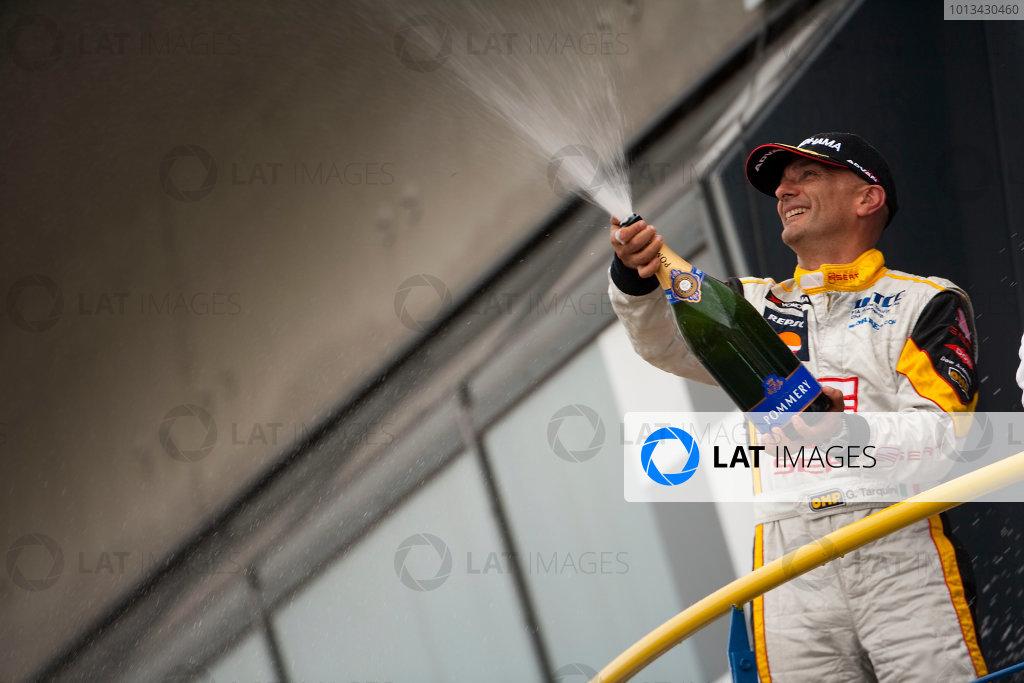 Oschersleben, Germany. 4th - 6th September 2009. Gabriele Tarquini, SEAT Leon 2 0 TDI celebrates on the podium. Portrait. World Copyright: Drew Gibson/LAT Photographic.ref: Digital Image _Y2Z9986