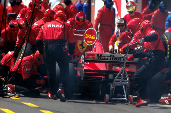 Imola, Italy.3-5 May 1996.Michael Schumacher (Ferrari F310) 2nd position, takes a pitstop.Ref-96 SM 11.World Copyright - LAT Photographic