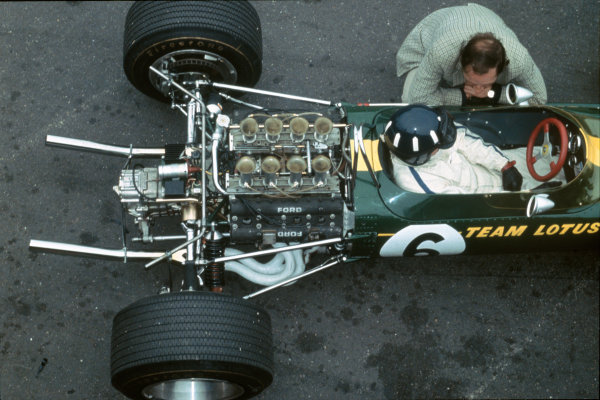 Zandvoort, Holland.  2-4 June 1967.  Graham Hill (Lotus 49 Ford). The new Ford Cosworth DFV V8 engine on the back of Graham Hill's Lotus 49. The unit won on its Grand Prix debut.  World Copyright: LAT Photographic. Ref:  67HOL01