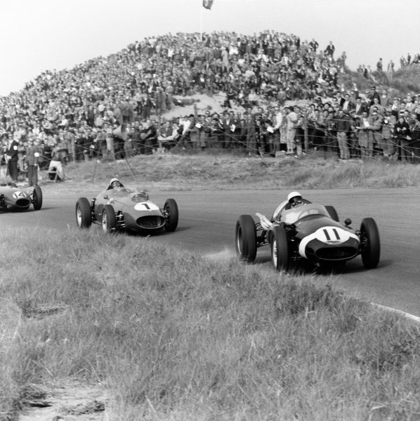 Zandvoort, Holland. 31 May 1959.Stirling Moss (Cooper T51-Climax), retired, leads Jean Behra (Ferrari Dino 246), 5th position and Graham Hill (Lotus 16-Climax), 7th position, action.World Copyright: LAT Photographic.Ref: 4122.