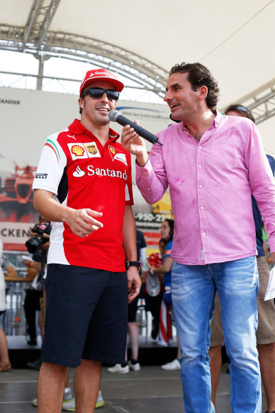 Hockenheimring, Hockenheim, Germany. Saturday 19 July 2014. Fernando Alonso, Ferrari, is interviewed on stage. World Copyright: Charles Coates/LAT Photographic. ref: Digital Image _J5R4472