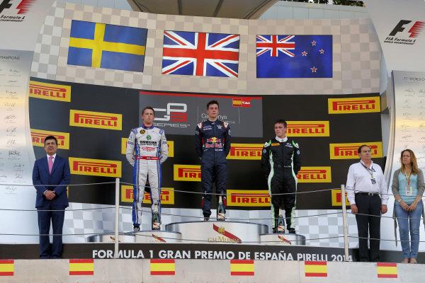 Race one podium (L to R): Second placed Jimmy Eriksson (SWE) Koiranen GP, race winner Alex Lynn (GBR) Carlin and third placed Richie Stanaway (NZL) Status Grand Prix. GP3 Series, Rd1, Barcelona, Spain, 9-11 May 2014.