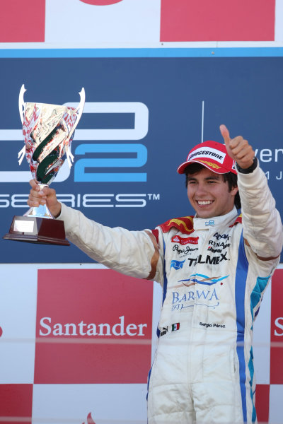Silverstone, England. 11th July.Sunday Race. Sergio Perez (MEX, Barwa Addax Team) celebrates his victory on the podium. Photo: Jakob Ebrey/GP2 Media Service.Ref: _MKO_9402 jpg