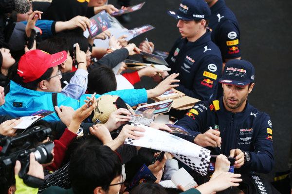 Shanghai International Circuit, Shanghai, China.  Thursday 06 April 2017.  Daniel Ricciardo, Red Bull Racing, and Max Verstappen, Red Bull, sign autographs for fans. World Copyright: Charles Coates/LAT Images  ref: Digital Image GJ9R7466