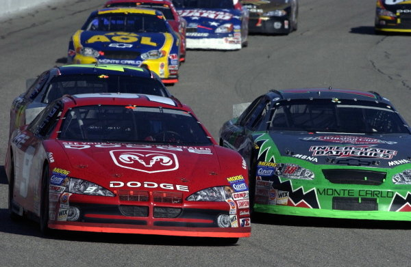 Race winner Bill Elliott (USA), Dodge Dealers, leads Bobby Labonte (USA), Interstate Batteries Chevrolet, who finished eighth. 