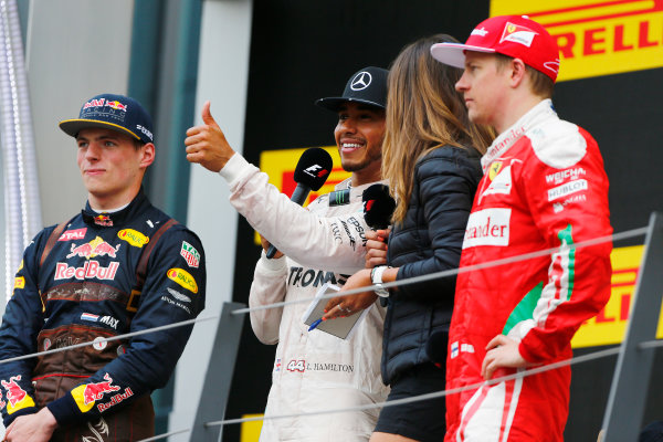 Red Bull Ring, Spielberg, Austria. Sunday 3 July 2016. Lewis Hamilton, Mercedes AMG, 1st Position, is interviewed on the podium alongside Max Verstappen, Red Bull Racing, 2nd Position, and Kimi Raikkonen, Ferrari, 3rd Position. World Copyright: Andrew Hone/LAT Photographic ref: Digital Image _ONZ7816