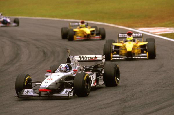 Interlagos, Brazil.28-30 March 1997.David Coulthard (McLaren MP4/12 Mercedes) followed by Giancarlo Fisichella and Ralf Schumacher (both Jordan 197 Peugeot).Ref-97 BRA 14.World Copyright - LAT Photographic