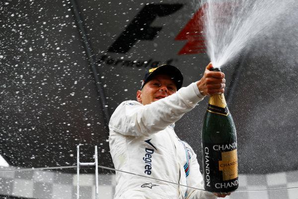 Circuit Gilles Villeneuve, Montreal, Canada. Sunday 12 June 2016. Valtteri Bottas, Williams Martini Racing, 3rd Position, sprays the Champagne. World Copyright: Steven Tee/LAT Photographic ref: Digital Image _H7I6018