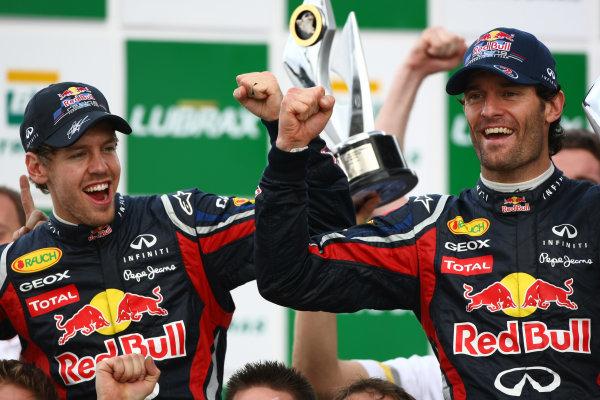Interlagos, Sao Paulo, Brazil.27th November 2011.Sebastian Vettel, Red Bull Racing RB7 Renault, 2nd position, and Mark Webber, Red Bull Racing RB7 Renault, 1st position. Portrait. Finish. World Copyright:Andy Hone/LAT Photographicref: Digital Image  CSP20803