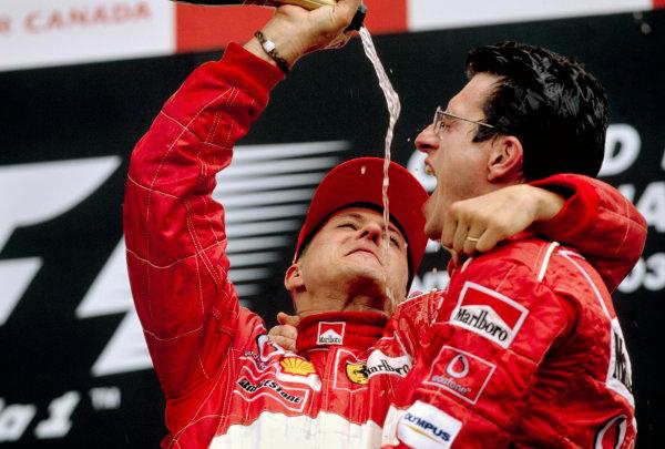 2003 Canadian Grand PrixMontreal, Canada. 13th - 15th June 2003.Race winner Michael Schumacher, Ferrari F2003 GA, celebrates with Jean Todt - podium.World Copyright: Steven Tee / LAT Photographic ref: 35mm Image 03Canada24