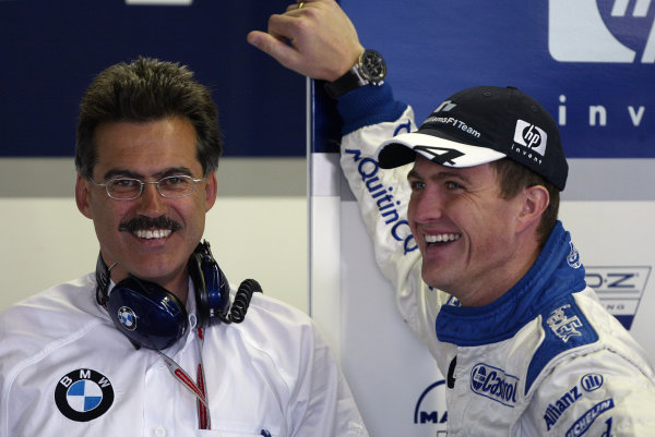 2004 Canadian Grand Prix - Saturday Qualifying,2004 Canadian Grand Prix Montreal, Canada. 12th June 2004 Ralf Schumacher, BMW Williams FW26 and Mario Theissen - smile at Williams' first pole position of the season. Portrait.World Copyright: Steve Etherington/LAT Photographic ref: Digital Image Only