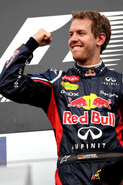 Bahrain International Circuit, Sakhir, Bahrain22nd April 2012Sebastian Vettel, Red Bull Racing, 1st position, celebrates on the podium.World Copyright: Andy Hone/LAT Photographicref: Digital Image HONY8613