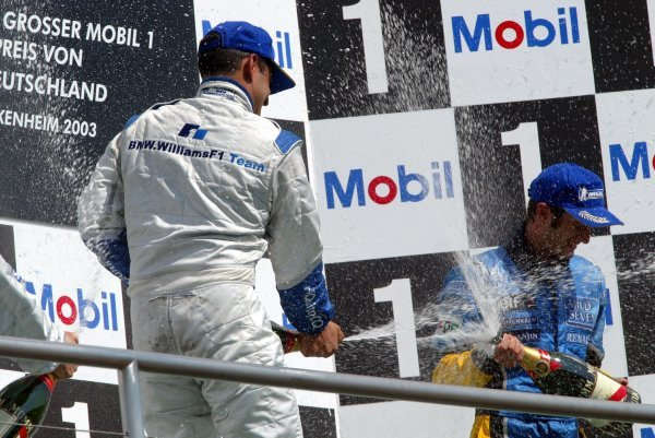 The podium (L to R): Race winner Juan Pablo Montoya (COL) Williams and third placed Jarno Trulli (ITA) Renault celebrate on the podium.