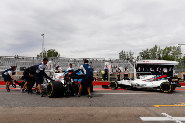 Circuit Gilles Villeneuve, Montreal, Canada. Friday 09 June 2017. Felipe Massa, Williams FW40 Mercedes, and Lance Stroll, Williams FW40 Mercedes, outside of the team's pit garage. World Copyright: Glenn Dunbar/LAT Images ref: Digital Image _31I4569