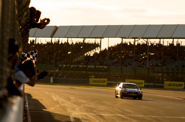 2015 British Touring Car Championship, Silverstone, Northamptonshire, England. 26th - 27th September 2015. Colin Turkington (GBR) Team BMR Volkswagen Passat CC, takes the chequered flag to win the race. World Copyright: Zak Mauger/LAT Photographic. ref: Digital Image _L0U4658