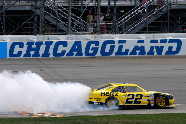20-21 July, 2013, Joliet, Illinois USA Joey Logano celebrates his victory with a burn out ©2013, Lesley Ann Miller LAT Photo USA