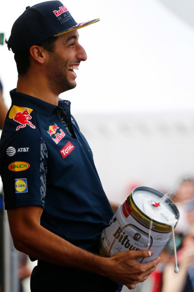 Hockenheim, Germany. Saturday 30 July 2016. Daniel Ricciardo, Red Bull Racing, carries a frothing, oversize, beercan. World Copyright: Andy Hone/LAT Photographic ref: Digital Image _ONY7711
