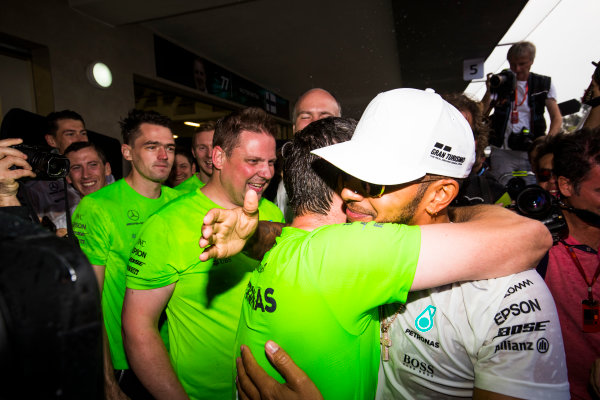 Autodromo Hermanos Rodriguez, Mexico City, Mexico. Sunday 29 October 2017. Lewis Hamilton, Mercedes AMG, celebrates with team mates after securing his 4th world drivers championship title. World Copyright: Sam Bloxham/LAT Images  ref: Digital Image _W6I1610