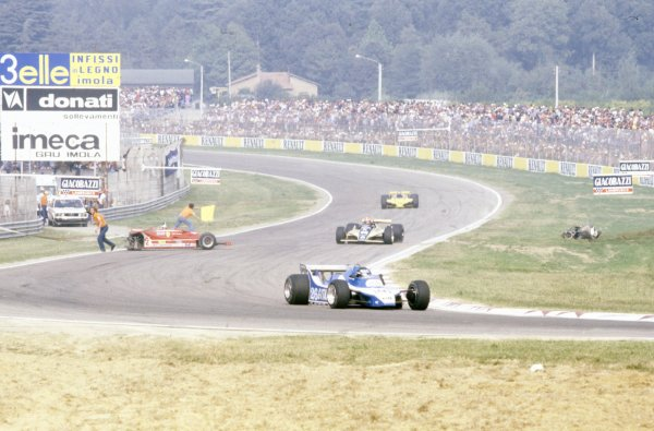 1980 Italian Grand Prix.Imola, Italy. 12-14 September 1980.Jacques Laffite (Ligier JS11/15-Ford Cosworth) leads Rupert Keegan (Williams FW07B-Ford Cosworth) and Emerson Fittipaldi (Fittipaldi F8-Ford Cosworth) passed the crashed Ferrari 312T5 of Gilles Villeneuve. Crash, accident.World Copyright: LAT PhotographicRef: 35mm transparency 80ITA02