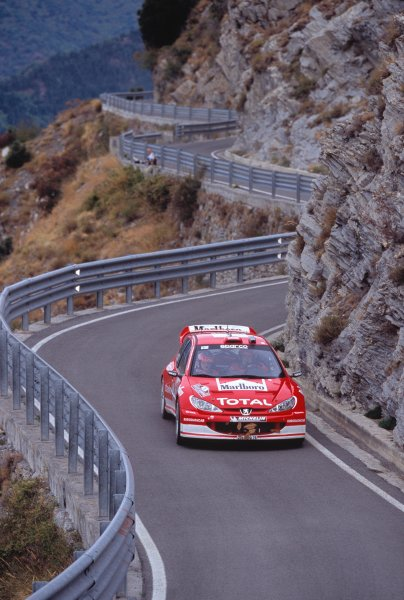 2003 World Rally ChampionshipRally of San Remo, Italy. 2nd - 5th October 2003.Marcus Gronholm / Timo Rautiainen, Peugeot 206 WRC. Twisty Mountain Roads, Cliff, Action.World Copyright: McKLEIN/LATref: 35mm Image WRCSANREMO15 jpg