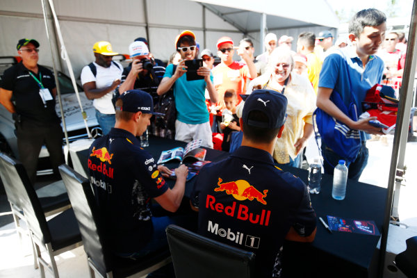 Circuit Gilles Villeneuve, Montreal, Canada. Thursday 08 June 2017. Max Verstappen, Red Bull Racing, signs autographs for fans alongside Daniel Ricciardo, Red Bull Racing.  World Copyright: Andy Hone/LAT Images ref: Digital Image _ONZ9860