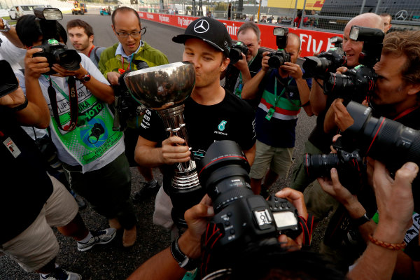 Suzuka Circuit, Japan. Sunday 9 October 2016. Nico Rosberg, Mercedes AMG, 1st Position, celebrates with his trophy. World Copyright: Dunbar/LAT Photographic ref: Digital Image _X4I8899