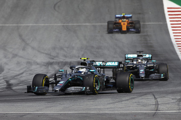 Valtteri Bottas, Mercedes AMG W10, leads Lewis Hamilton, Mercedes AMG F1 W10, and Lando Norris, McLaren MCL34