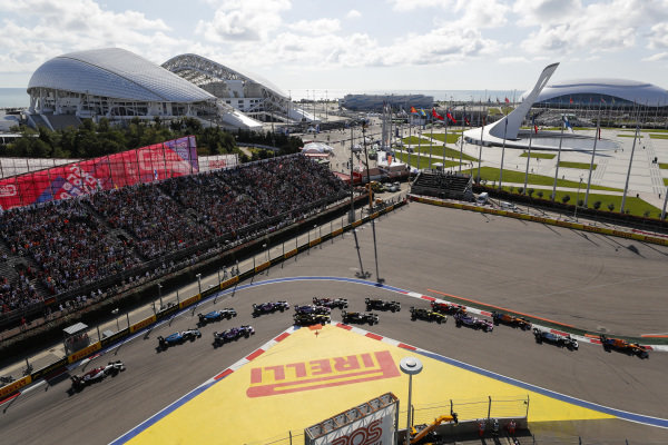 Carlos Sainz Jr., McLaren MCL34, leads Valtteri Bottas, Mercedes AMG W10, Lando Norris, McLaren MCL34, Sergio Perez, Racing Point RP19, Max Verstappen, Red Bull Racing RB15, Nico Hulkenberg, Renault R.S. 19 and the rest of the pack at the start
