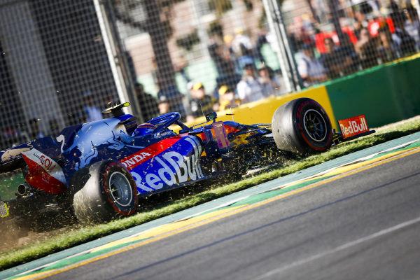 Alexander Albon, Toro Rosso STR14, takes to the grass