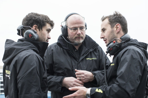 Engineers talk to the drivers