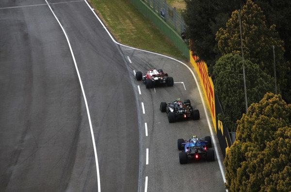 Kimi Raikkonen, Alfa Romeo Racing C41, leads Valtteri Bottas, Mercedes W12, and Esteban Ocon, Alpine A521, to the grid