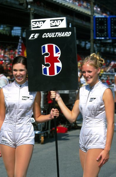 David Coulthard (GBR), McLaren Mercedes, was spoiled by having two grid girls.