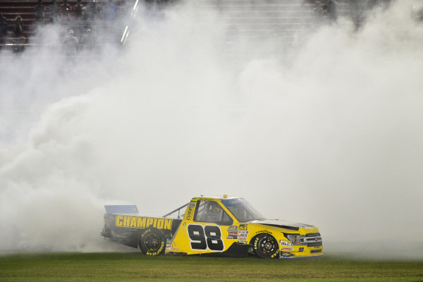 #98: Grant Enfinger, ThorSport Racing, Ford F-150 celebrates with a burnout after winning
