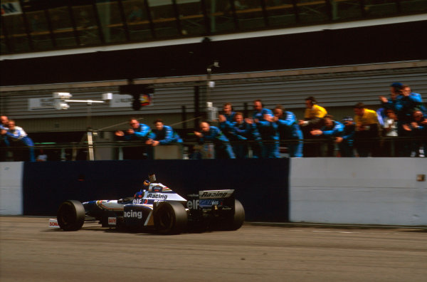 Silverstone, England.12-14 July 1996.Jacques Villeneuve (Williams FW18 Renault) punches the air and gets the applause as he takes the win.Ref-96 GB 13.World Copyright - LAT Photographic