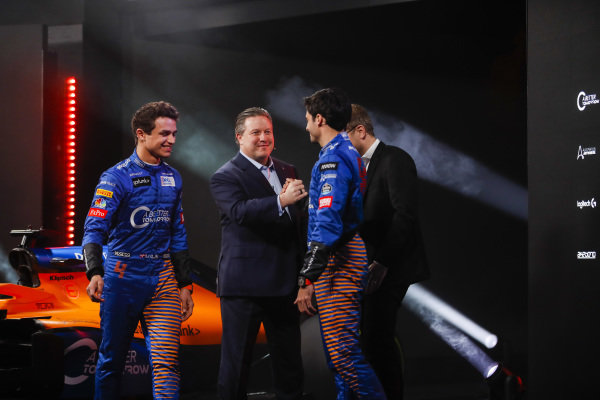 Lando Norris, McLaren, and Carlos Sainz Jr, McLaren, are greeted by Zak Brown, Executive Director, McLaren, and Andreas Seidl, Team Principal, McLaren