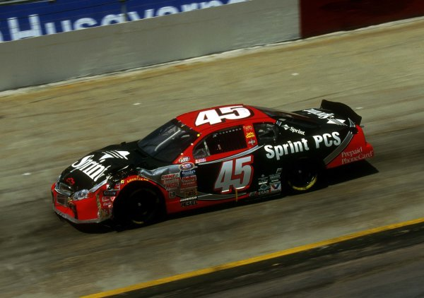 Showing some front end bodywork damage Adam Petty races around the track at Bristol this past March.