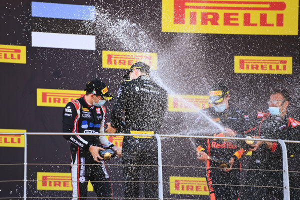 Winner Christian Lundgaard (DNK, ART GRAND PRIX) celebrates on the podium and sprays champagne with Louis Deletraz (CHE, CHAROUZ RACING SYSTEM) and Juri Vips (EST, DAMS)