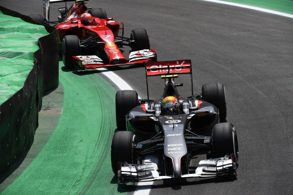 Esteban Gutierrez (MEX) Sauber C33 and Kimi Raikkonen (FIN) Ferrari F14 T. Formula One World Championship, Rd18, Brazilian Grand Prix, Race, Sao Paulo, Brazil, Sunday 9 November 2014.