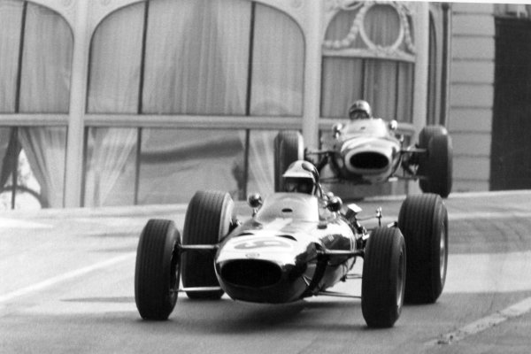 1966 Monaco Grand Prix.Monte Carlo, Monaco. 22 May 1966.Bob Bondurant, BRM P261, 4th position, leads Graham Hill, BRM P261, 3rd position, action.World Copyright: LAT PhotographicRef: Motor b&w print