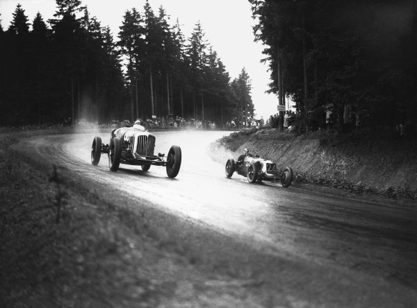 Nurburgring, Germany. 19th July 1931. Phil (Red) Shafer (Shafer Special), retired, passes Henry Birkin (Maserati 26M), 10th position, action.  World Copyright: LAT Photographic. Ref:  Autocar Glass Plate B6829