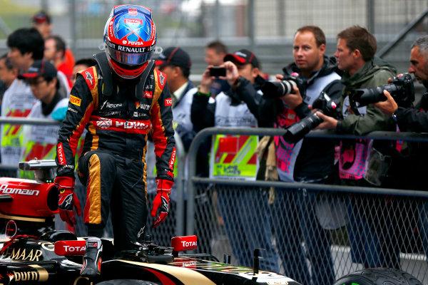Shanghai International Circuit, Shanghai, China. Saturday 19 April 2014. Romain Grosjean, Lotus F1, arrives in Parc Ferme after qualifying. World Copyright: Andy Hone/LAT Photographic. ref: Digital Image _ONZ5320