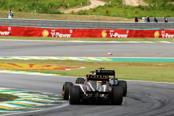 Bruno Senna (BRA) Lotus Renault GP R31 and Heikki Kovalainen (FIN) Team Lotus T128. Formula One World Championship, Rd 19, Brazilian Grand Prix, Race, Interlagos, Sao Paulo, Brazil, Sunday 27 November 2011.