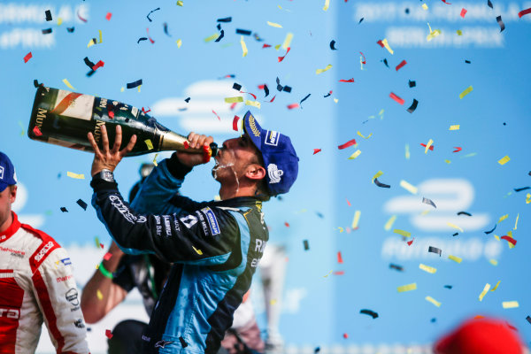 2016/2017 FIA Formula E Championship. Round 8 - Berlin ePrix, Tempelhof Airport, Berlin, Germany. Sunday 11 June 2017. Sebastien Buemi (SUI), Renault e.Dams, Spark-Renault, Renault Z.E 16, sprays the champagne on the podium. Photo: Alastair Staley/LAT/Formula E ref: Digital Image _X0W1833